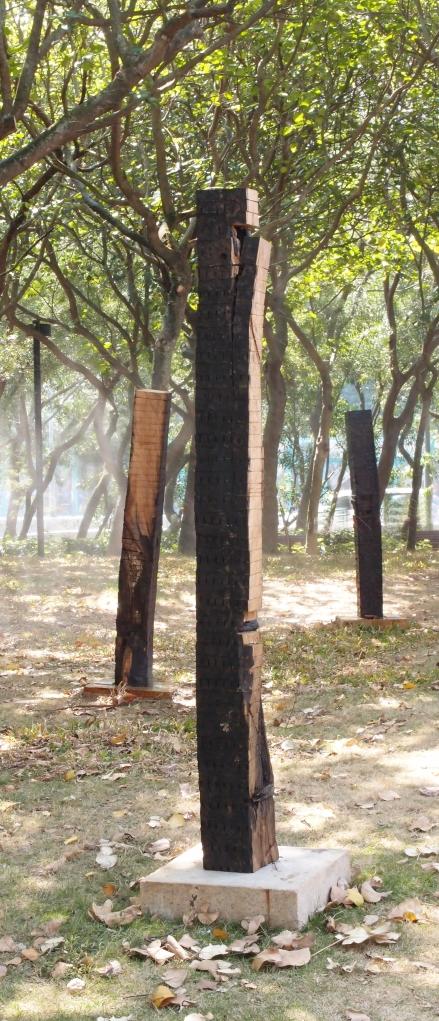 Slice                       2012-13  Wood,  3 columns for a set, 160 (H) x 18(W) x 18(D)cm  each column. Quarry Bay Park